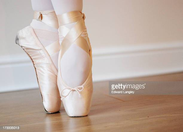 Pointe shoes of a ballerina