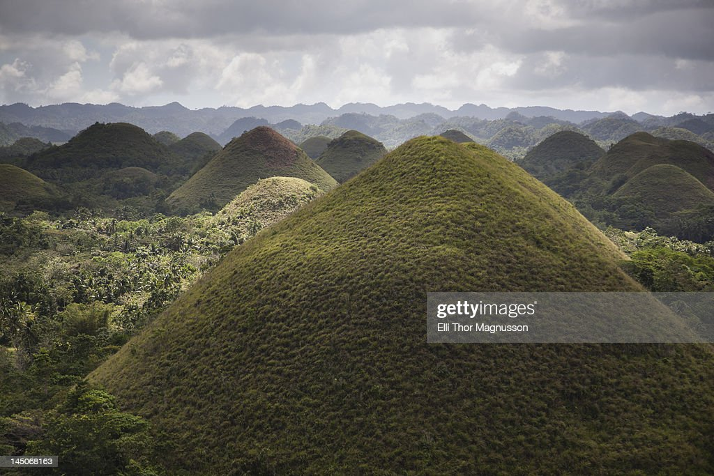Pointed hills in rural landscape : Stock Photo