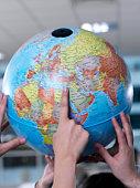 Pointing At Globe