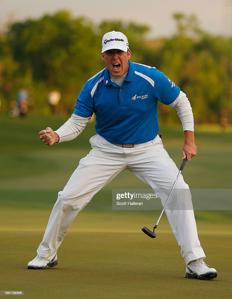 A Points celebrates his par putt on the 18th green during the final round of the Shell Houston Open at the Redstone Golf Club on March 31 2013 in...