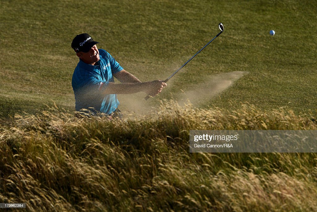 Points of the United States plays out of a bunker on the 17th hole during the first round of the 142nd Open Championship at Muirfield on July 18, 2013 in Gullane, Scotland.