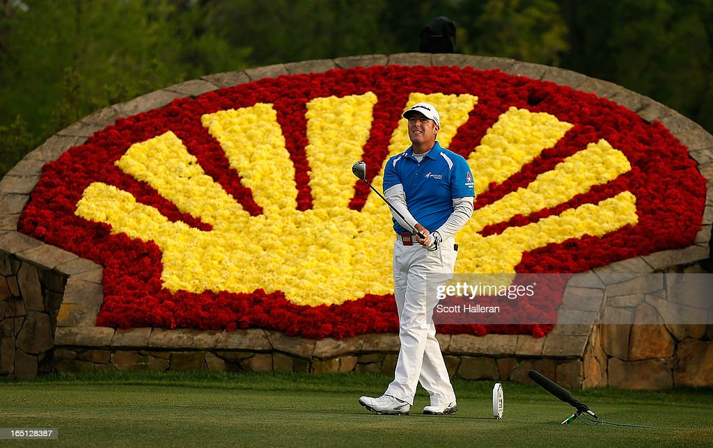 A Points watches his tee shot on the 18th hole during the final round of the Shell Houston Open at the Redstone Golf Club on March 31 2013 in Humble...
