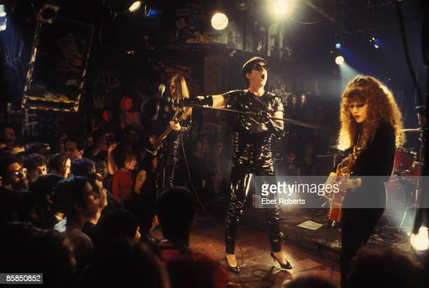 S Photo of Poison IVY and Lux INTERIOR and CRAMPS Lux Interior and Poison Ivy performing on stage at CBGB's in New York