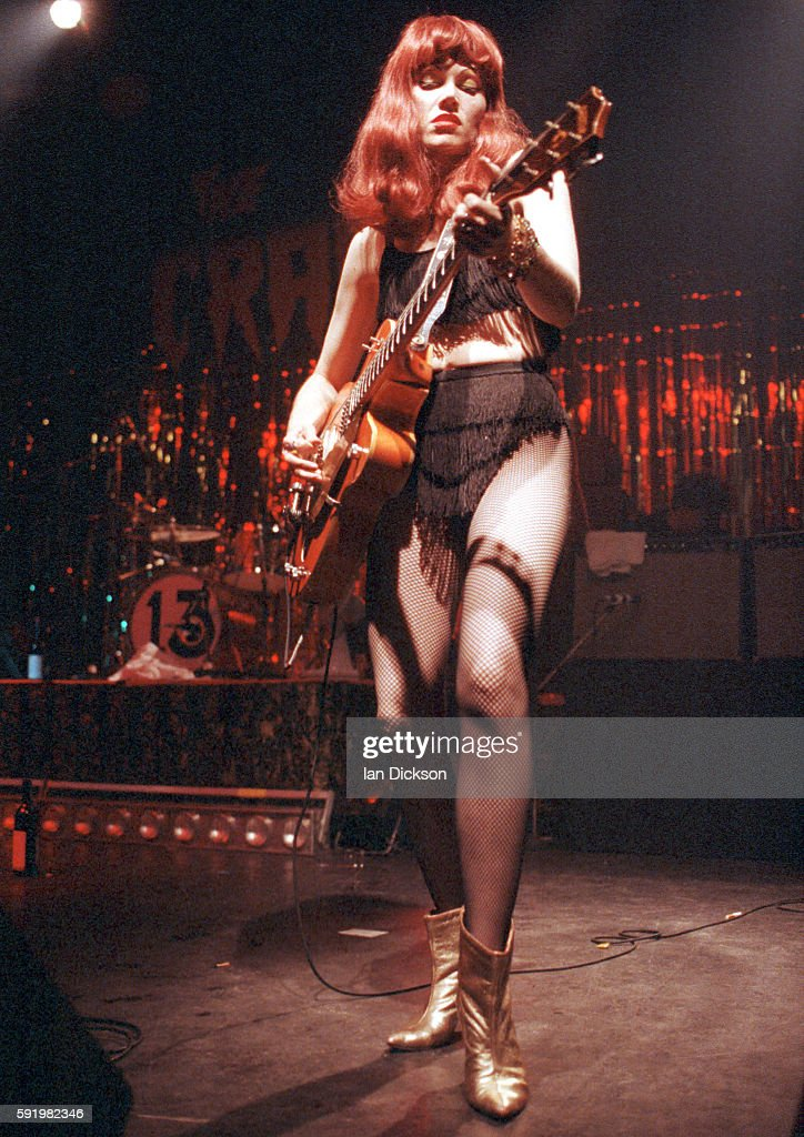 Poison Ivy of The Cramps performing on stage at The Forum Kentish Town London 29 October 1991