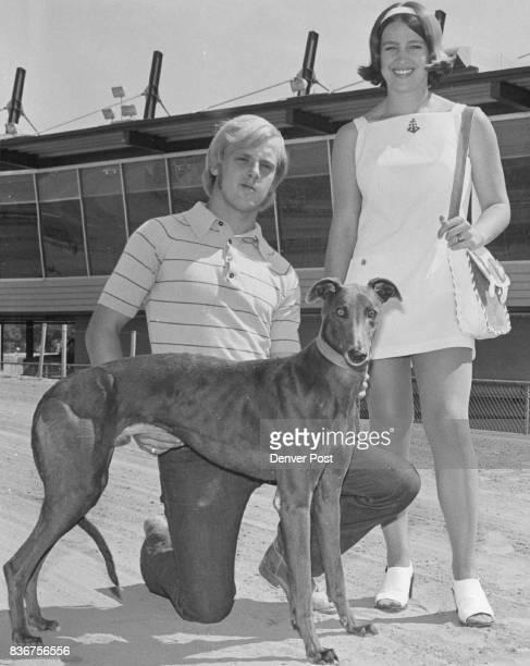 Poison Love Introduced Trainer Rick Bartley left of the Don Bartley Kennel and Dianna Burnham show the greyhound Poison Love at Pueblo Greyhound Park...