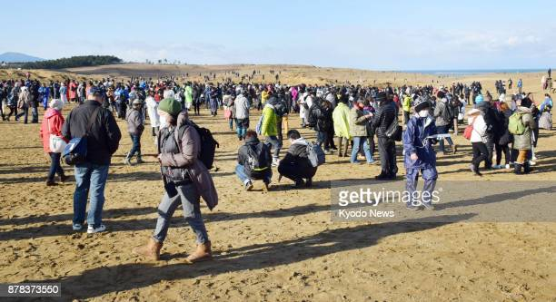 Pokemon Go fans play the popular smartphone game app at the Tottori Sand Dunes in Tottori Prefecture on Nov 24 as a threeday event for Pokemon Go...