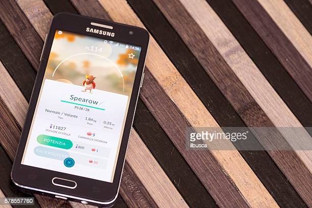 Pokemon go on Samsung smartphone on striped wood table