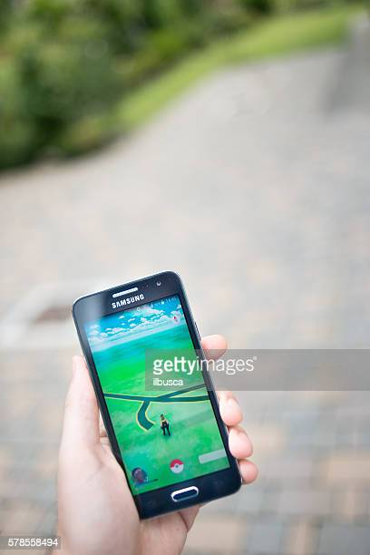 Pokemon go on Samsung smartphone outdoor