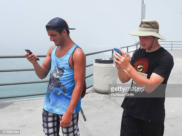 Pokemon Go players on the Huntington Pier during the Vans Us open of Surfing on July 23 2016 in Los Angeles California
