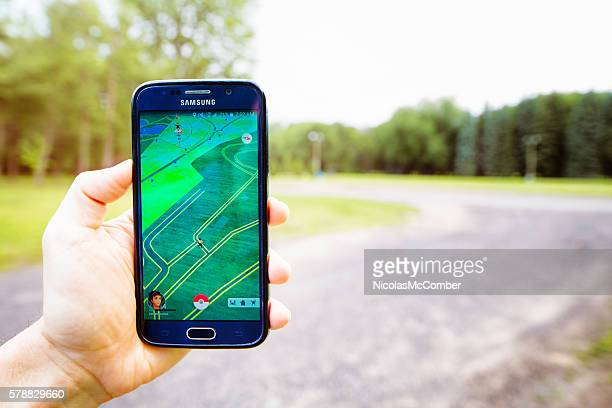 Pokemon hunting in a park with mobile phone app
