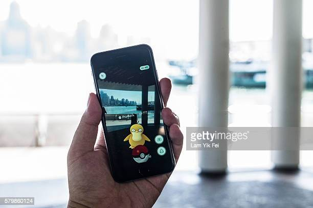 Pokemon species Psyduck is seen in the Pokemon Go game on July 25 2016 in Tsim Sha Tsui Hong Kong 'Pokemon Go' which has been a smashhit across the...