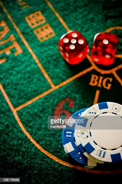 Poker Chips and Dice on Table