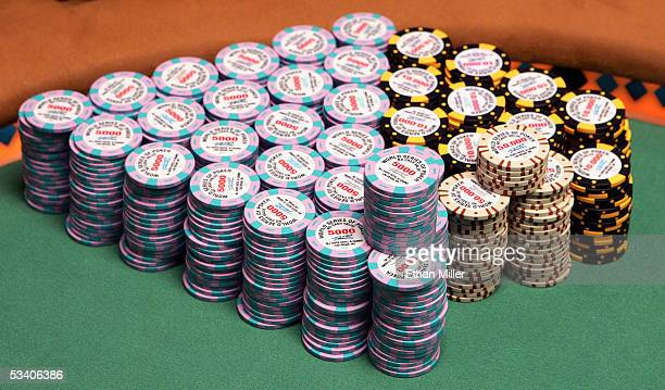 Poker chips are seen stacked on the main table during the sixth round of the World Series of Poker nolimit Texas Hold 'em main event at Binion's...