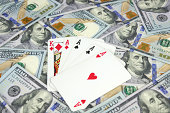 Poker of aces over new one hundred dollar bills