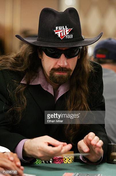 Poker player Chris 'Jesus' Ferguson folds as he competes on the second day of the first round of the World Series of Poker nolimit Texas Hold 'em...