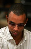 Poker player Phil Ivey watches other players as he competes on the second day of the first round of the World Series of Poker nolimit Texas Hold 'em...