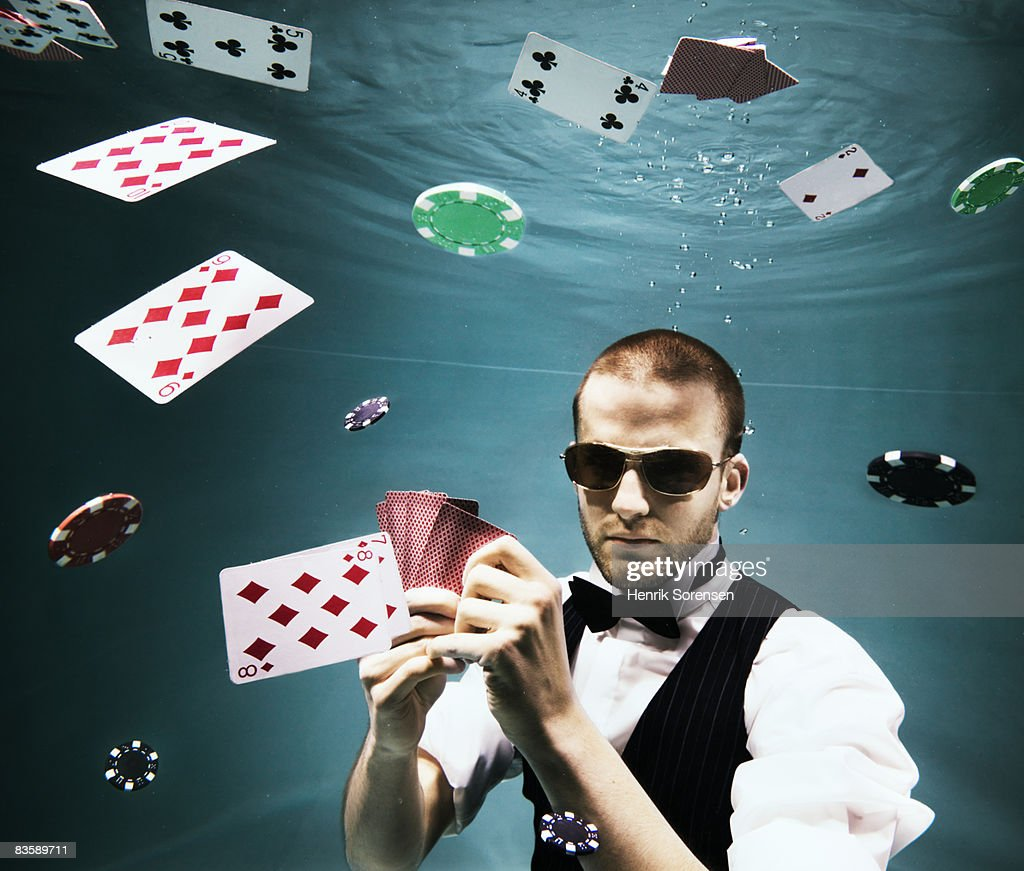Poker player under water : Stock Photo