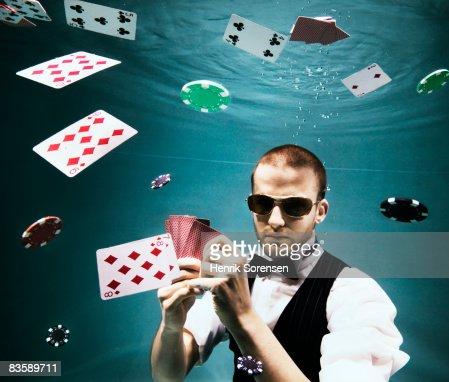 Poker player under water : Stock Photo