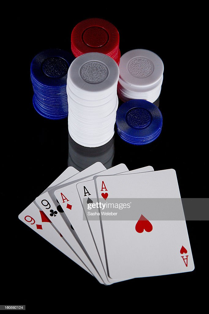 Poker playing cards and poker chips : Stock Photo
