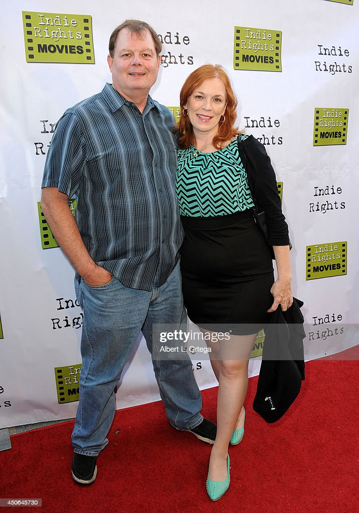 Poker Pro Mike Clark and producer Kitty Clark arrive for the Premiere Of 'The World Famous Kid Detective' held at The Arena Theater on June 14, 2014 in Hollywood, California.