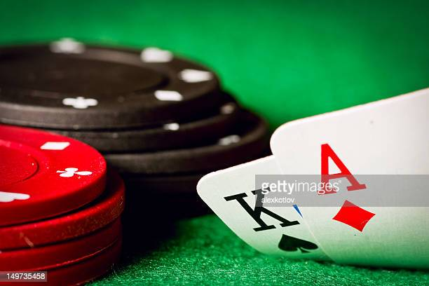 Poker table with poker chips and an ace and a king cards