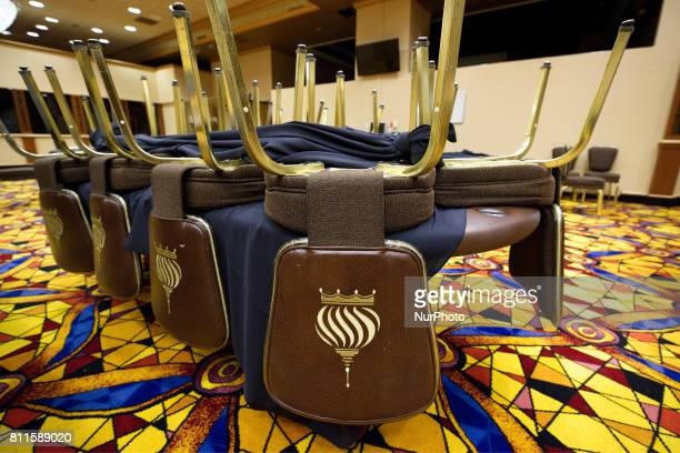 Poker tables and chairs are up for sale as members of the public browse the inventory of the closed Trump Taj Mahal Casino and resort during a large...