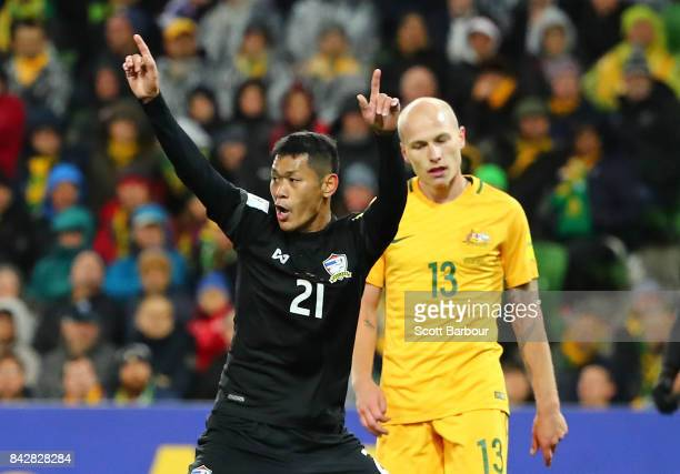 Pokkhao Anan of Thailand celebrates after scoring a goal as Aaron Mooy of the Socceroos looks dejected during the 2018 FIFA World Cup Qualifier match...