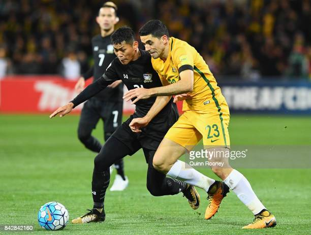 Pokklaw ANan of Thailand and Tomas Rogic of Australia compete for the ball during the 2018 FIFA World Cup Qualifier match between the Australian...