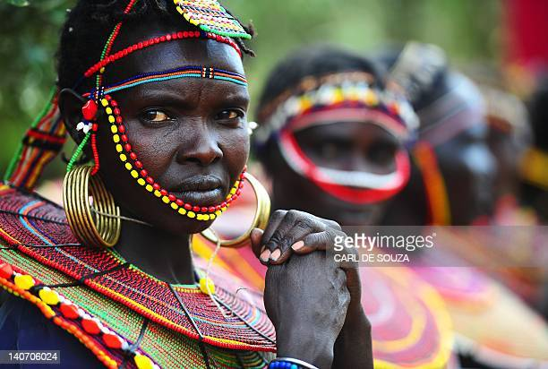 Pokot tribeswomen look on at the Gallmann nature conservancy near Kinamba Laikipia Northern Kenya on March 4 2012 High Priest Shinso Ito and a group...