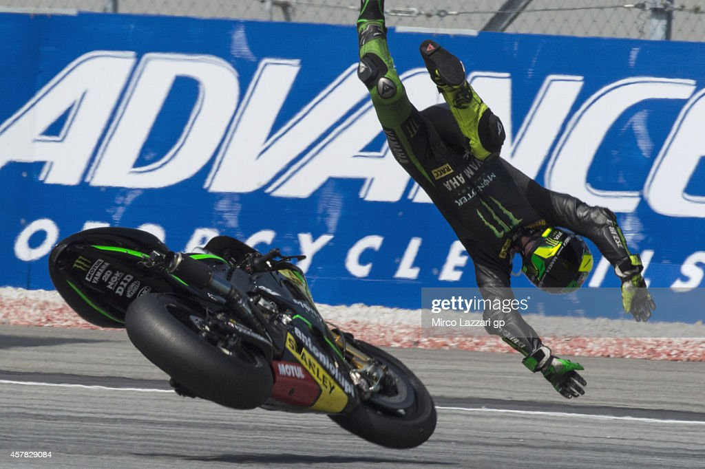 <a gi-track='captionPersonalityLinkClicked' href=/galleries/search?phrase=Pol+Espargaro&family=editorial&specificpeople=3211455 ng-click='$event.stopPropagation()'>Pol Espargaro</a> of Spain and Monster Yamaha Tech 3 crashes out during the MotoGP Of Malaysia - Qualifying at Sepang Circuit on October 25, 2014 in Kuala Lumpur, Malaysia.