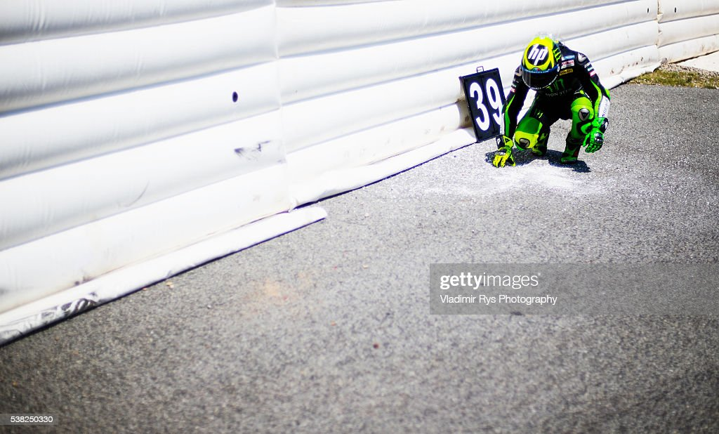 Pol Espargaro of Spain and Monster Yamaha Tech 3 leaves a sign with number to honour Moto 2 rider Luis Salom of Spain and SAG Team who died after...