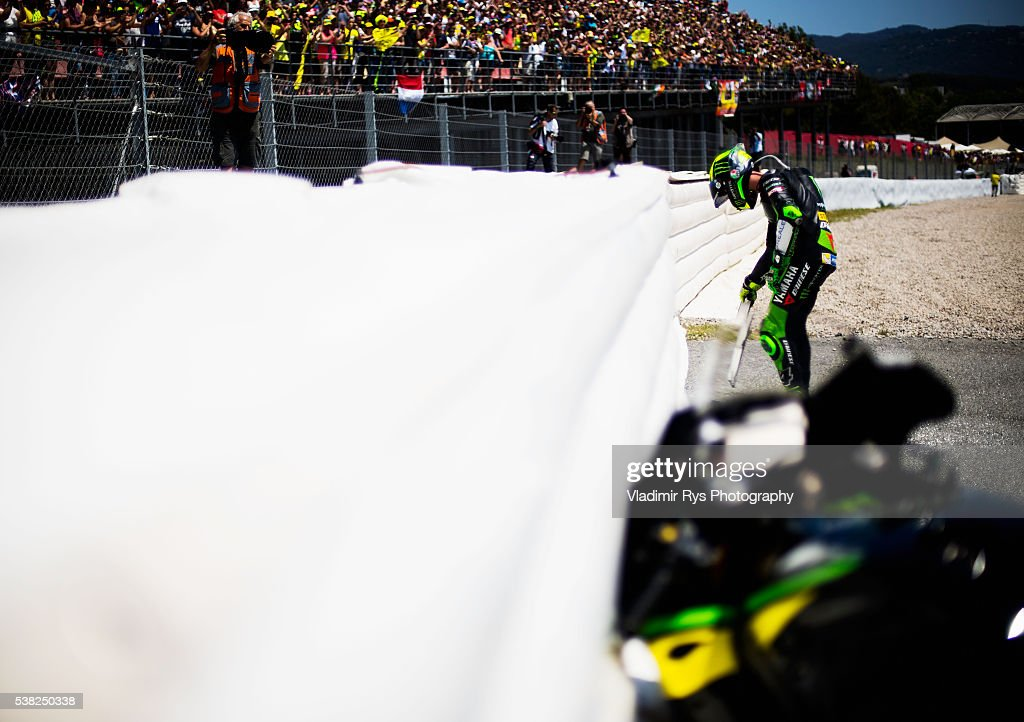 <a gi-track='captionPersonalityLinkClicked' href=/galleries/search?phrase=Pol+Espargaro&family=editorial&specificpeople=3211455 ng-click='$event.stopPropagation()'>Pol Espargaro</a> of Spain and Monster Yamaha Tech 3 leaves a sign with number #39 to honour Moto 2 rider Luis Salom of Spain and SAG Team who died after sustaining injuries in a crash during Friday's practice session following the MotoGP of Catalunya at Circuit de Barcelona on June 05, 2016 in Montmelo, Spain.