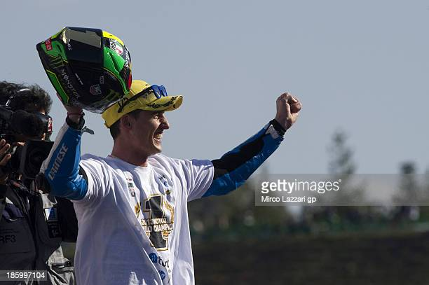 Pol Espargaro of Spain and Pons 40 HP Tuenti celebrates winning the Moto2 race to claim the 2013 Moto2 World Championship title on the podium during...