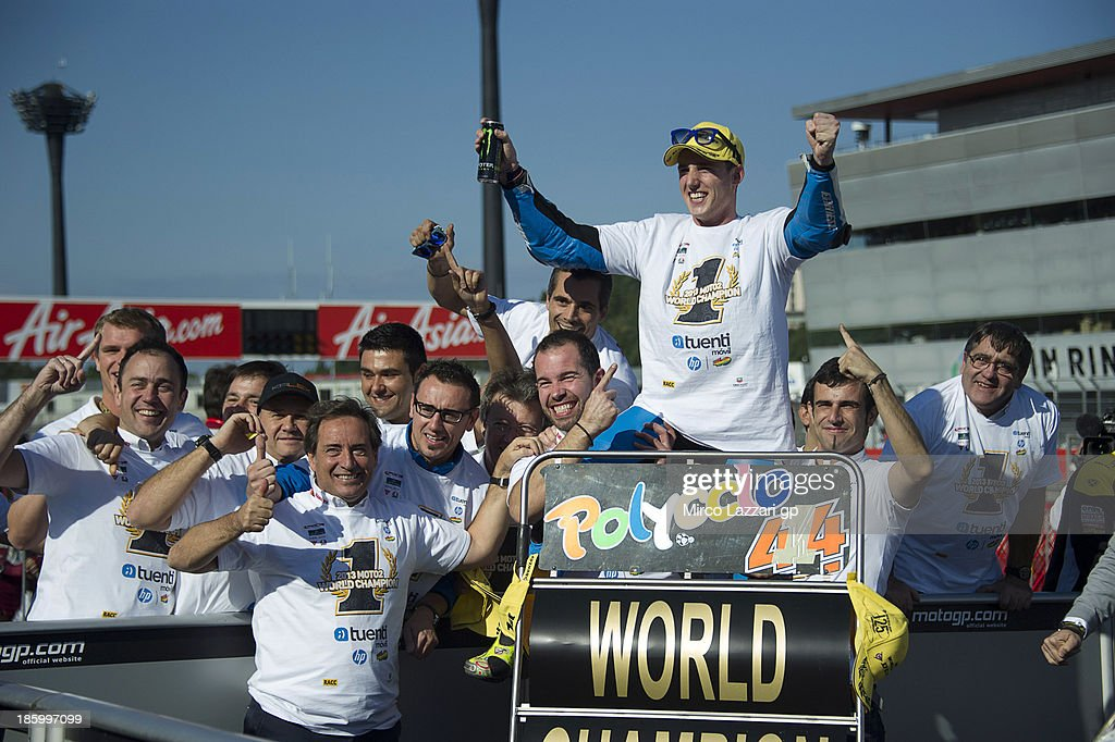 <a gi-track='captionPersonalityLinkClicked' href=/galleries/search?phrase=Pol+Espargaro&family=editorial&specificpeople=3211455 ng-click='$event.stopPropagation()'>Pol Espargaro</a> of Spain and Pons 40 HP Tuenti celebrates with his team after winning the Moto2 race to claim the 2013 Moto2 World Championship title during the MotoGP of Japan at Twin Ring Motegi on October 27, 2013 in Motegi, Japan.