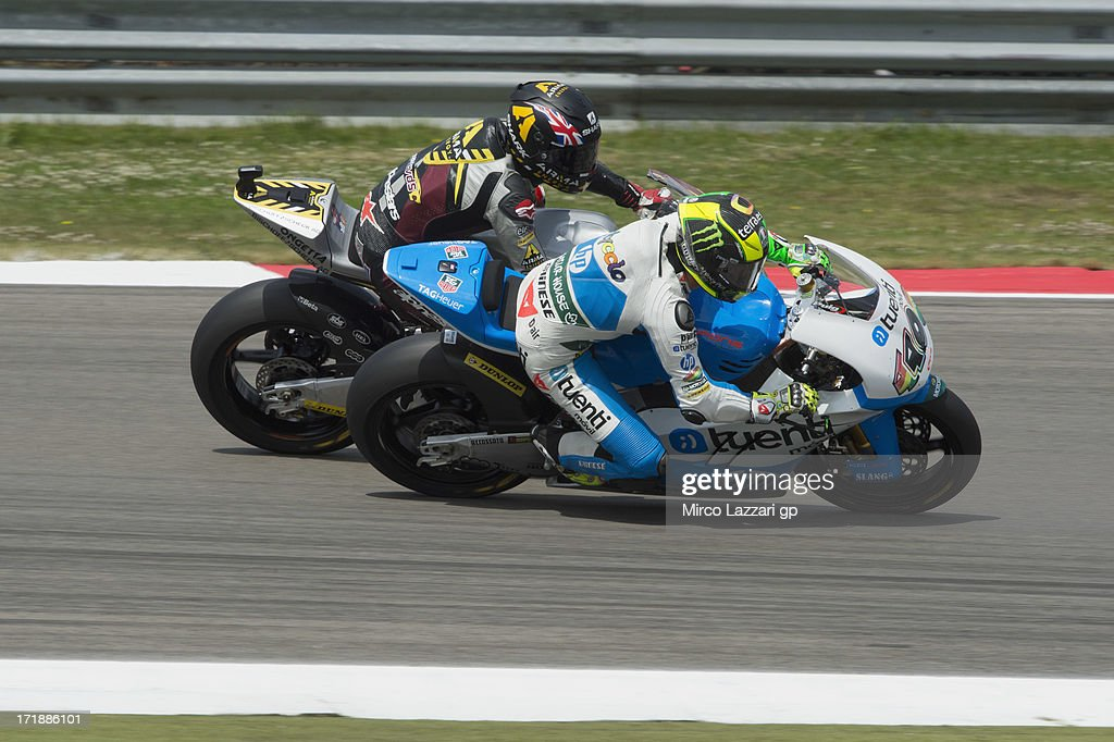 Pol Espargaro of Spain and Pons 40 HP Tuenti leads Scott Redding of Great Britain and Marc VDS Racing Team during the Moto2 race during the MotoGp Of Holland - Race at TT Circuit Assen on June 29, 2013 in Assen, Netherlands.