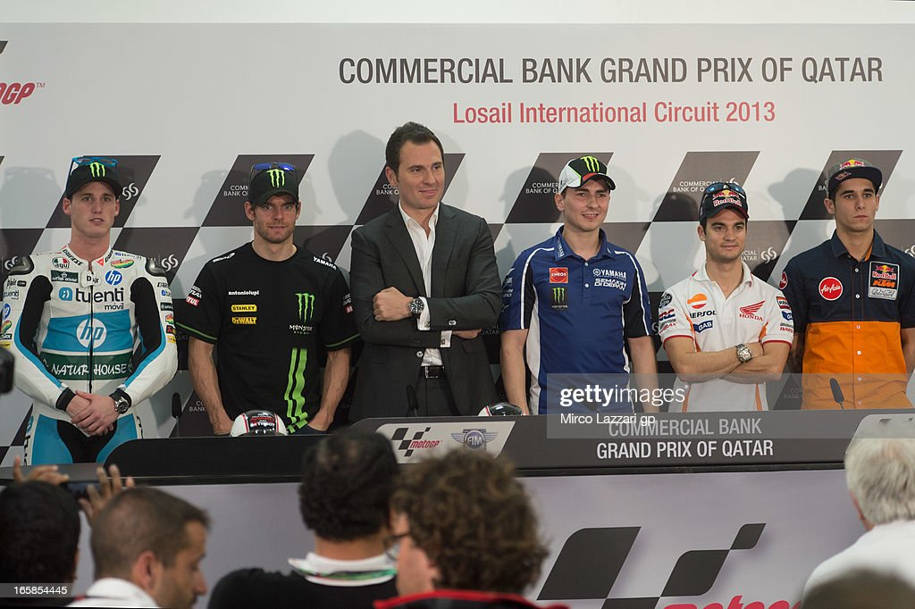 Pol Espargaro of Spain and Pons 40 HP Tuenti, Luis Salom of Spain and Red Bull KTM Ajo, Cal Crutchlow of Great Britain and Monster Yamaha Tech 3, Jorge Lorenzo of Spain and Yamaha Factory Racing, Dani Pedrosa of Spain and Repsol Honda Team and Luis Salom of Spain and Red Bull KTM Ajo pose during the press conference at the end of the qualifying practice during the MotoGp of Qatar - Qualifying at Losail Circuit on April 6, 2013 in Doha, Qatar.