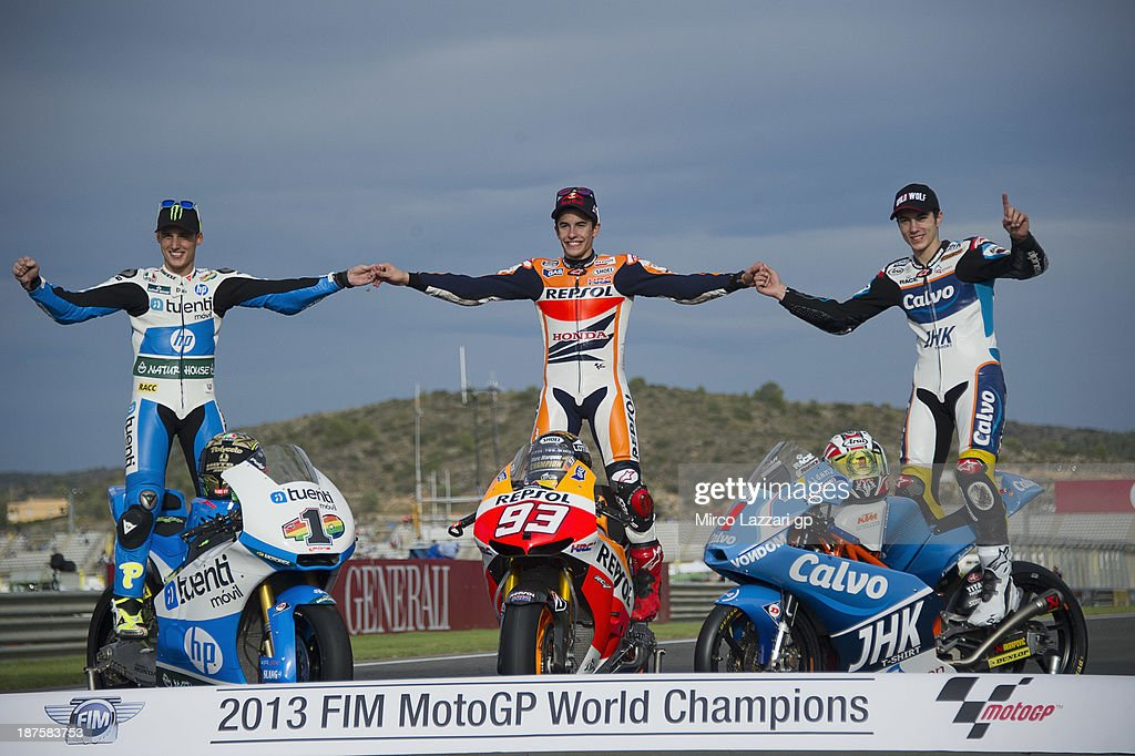 <a gi-track='captionPersonalityLinkClicked' href=/galleries/search?phrase=Pol+Espargaro&family=editorial&specificpeople=3211455 ng-click='$event.stopPropagation()'>Pol Espargaro</a> of Spain and Pons 40 HP Tuenti, <a gi-track='captionPersonalityLinkClicked' href=/galleries/search?phrase=Marc+Marquez&family=editorial&specificpeople=5409395 ng-click='$event.stopPropagation()'>Marc Marquez</a> of Spain and Repsol Honda Team and <a gi-track='captionPersonalityLinkClicked' href=/galleries/search?phrase=Maverick+Vinales&family=editorial&specificpeople=7535430 ng-click='$event.stopPropagation()'>Maverick Vinales</a> of Spain and Team Calvo (World Champions) pose on track during the MotoGP of Valencia - Race at Ricardo Tormo Circuit on November 10, 2013 in Valencia, Spain.