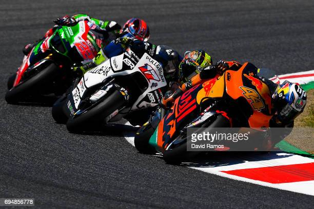 Pol Espargaro of Spain and Red Bull KTM Factory Racing rides ahead Karel Abraham of Czech Republic and PullBear Aspar Team and Sam Lowes of Great...