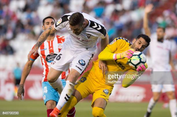Polaco Rafa Galvez and Tomeu Nadal fight for a ball during the La Liga second league match between Albacete Balompié and Club deportivo Lugo at...
