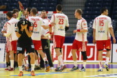 Poland celebrates the 3332 victory and Uwe Gensheimer of Germany looks dejected after the Men's European Handball Championship second round group one...
