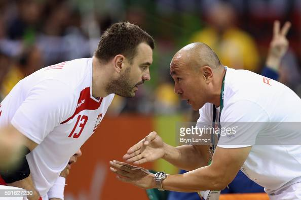 Poland Coach Talant Dujshebaev talks to Bartosz Jurecki during the Men's Quarterfinal Handball contest between Croatia and Poland at the Future Arena...