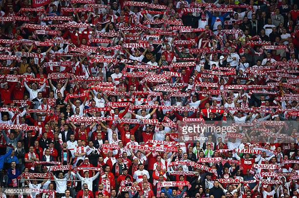 Poland fans hold scarves during the EURO 2016 Qualifier Group D match between Germany and Poland at CommerzbankArena on September 4 2015 in Frankfurt...