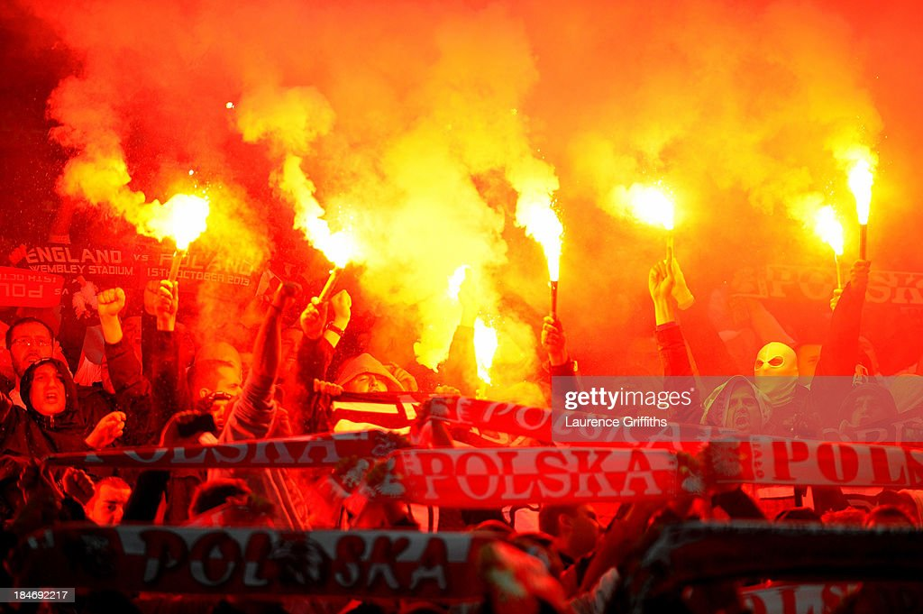 Poland fans light flares prior to the FIFA 2014 World Cup Qualifying Group H match between England and Poland at Wembley Stadium on October 15, 2013 in London, England.