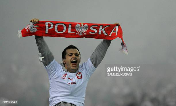 A Poland football team fan holds up a scarf during the World Cup 2010 qualifying soccer match against Slovakia on October 15 2008 in Bratislava AFP...