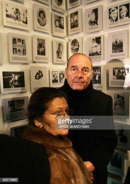 French President Jacques Chirac and former Auschwitz prisoner and former French Health Minister Simone Veil look at pictures in an exhibition they...