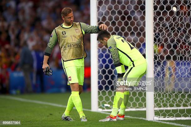 Poland goalkeeper Artur Boruc and Poland goalkeeper Lukasz Fabianski look dejected after their side lost the penalty shootout