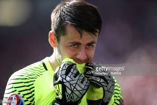 Poland goalkeeper Lukasz Fabianski appears nervous before the final penalty is taken in the shootout by teammate Grzegorz Krychowiak