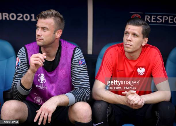 Poland goalkeepers Artur Boruc and Wojciech Szczesny on the bench before the game