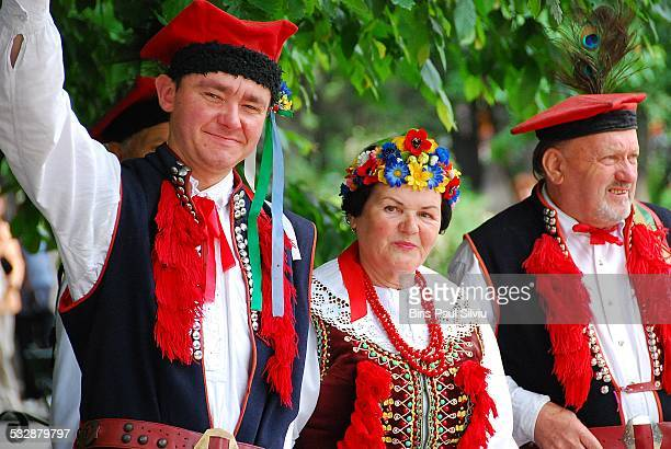 Poland Krakow Group of adults Poles in folk traditional costume