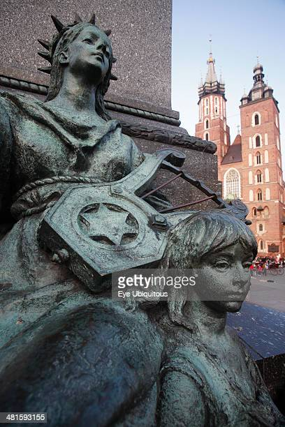 Poland Krakow Stare Miasto Rynek Glowny Detail of memorial statue of the Romantic poet Adam Mickiewicz designed by Teodor Rygier in 1898 Allegorical...